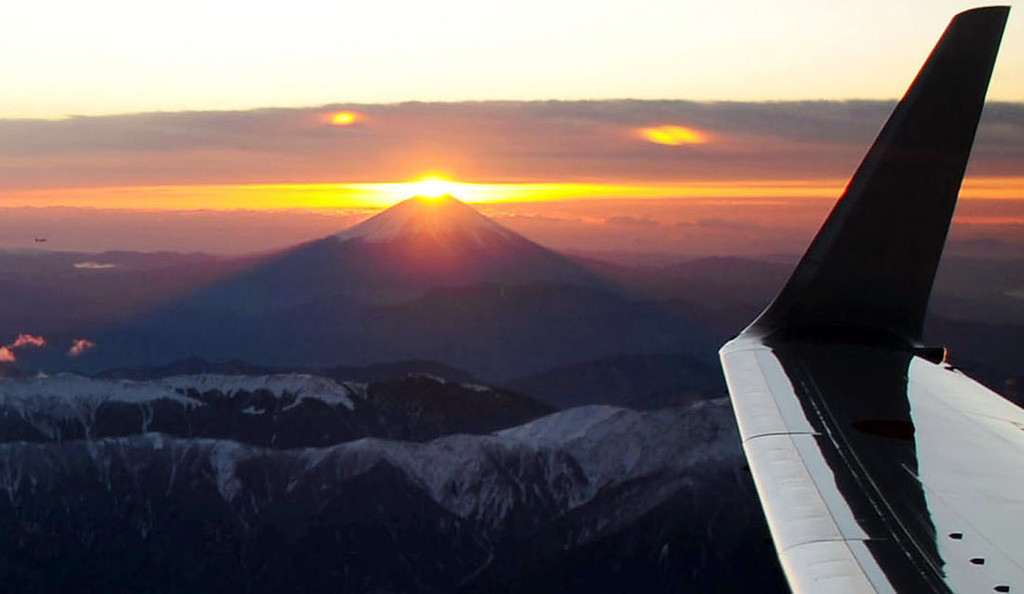 . The sun rises over the Mt. Fuji, seen from a charted plane on Tuesday, Jan. 1, 2013. (AP Photo/Kyodo News)