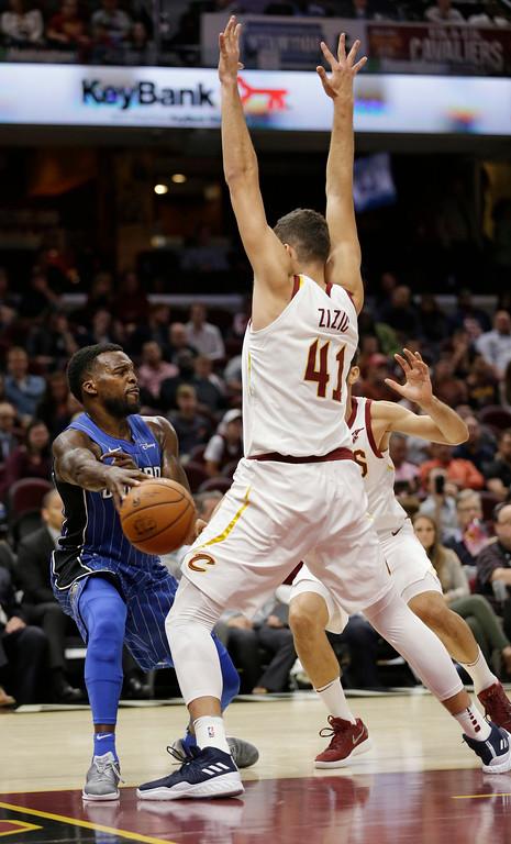 . Orlando Magic\'s Shelvin Mack (7) passes around Cleveland Cavaliers\' Ante Zizic (41), from Croatia, in the second half of an NBA basketball game, Saturday, Oct. 21, 2017, in Cleveland. (AP Photo/Tony Dejak)
