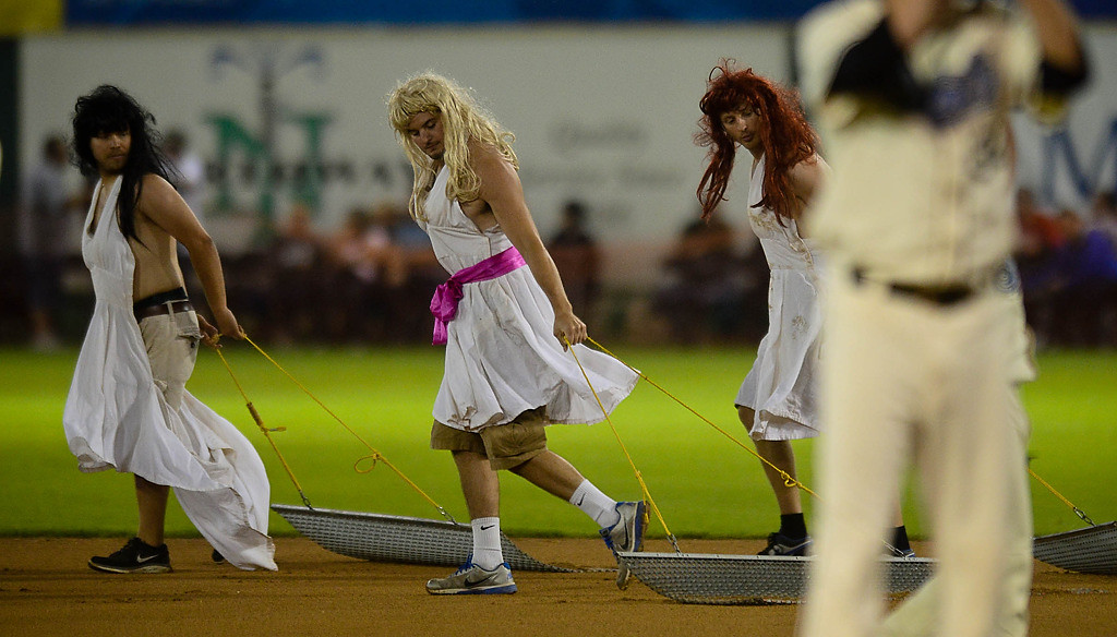 ". The grounds crew ""drags\"" the field between innings. (Pioneer Press: Ben Garvin)"