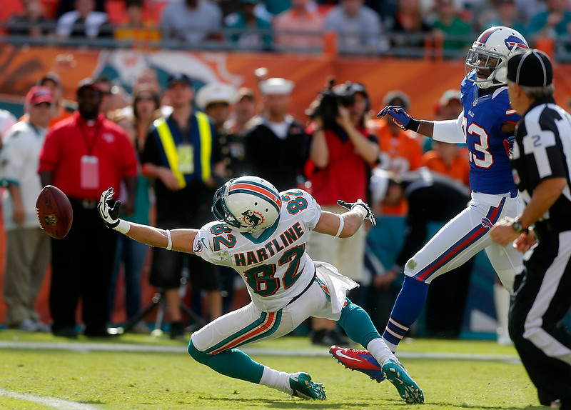 . Miami Dolphins wide receiver Brian Hartline (82) cannot reach a pass as Buffalo Bills cornerback Aaron Williams (23) defends in the second half of an NFL football game on Sunday, Dec. 23, 2012, in Miami. (AP Photo/John Bazemore)