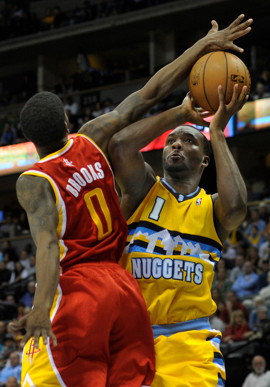 . DENVER, CO. - APRIL 6: Aaron Brooks (0) of the Houston Rockets blocked a shot coming from Jordan Hamilton (1) of the Denver Nuggets in the second half. The Denver Nuggets defeated the Houston Rockets 132-114 at the Pepsi Center Saturday night, April 6, 2013. Photo By Karl Gehring/The Denver Post)