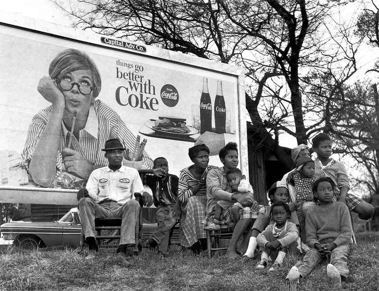 """""""Things Go Better With Coke"""" sign with multi-generational family watching Selma marchers.  Selma To Montgomery, Alabama Civil Rights March, March 25, 1965"""