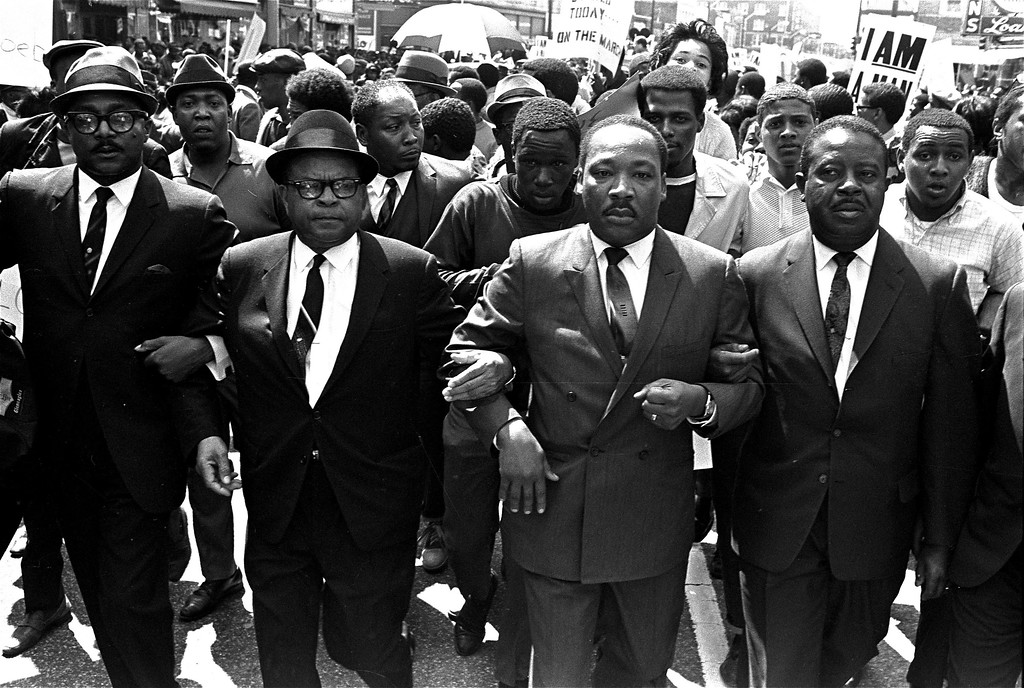 . The Rev. Ralph Abernathy, right, and Bishop Julian Smith, left, flank Dr. Martin Luther King, Jr., during a civil rights march in Memphis, Tenn., March 28, 1968.  (AP Photo/Jack Thornell)