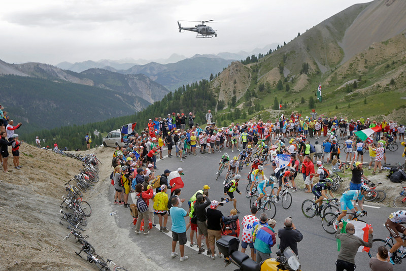 . The pack with Italy\'s Vincenzo Nibali, wearing the overall leader\'s yellow jersey, climbs Izoard pass during the fourteenth stage of the Tour de France cycling race over 177 kilometers (110 miles) with start in Grenoble and finish in Risoul, France, Saturday, July 19, 2014. (AP Photo/Laurent Cipriani)