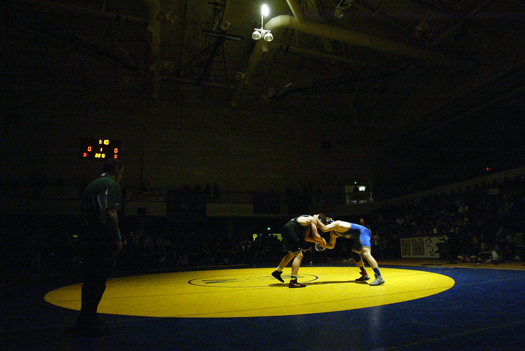 . Terra Linda\'s Nathaniel Keeve, right, faces off against Sonoma\'s Aidan Lacy in the 220-pound finals at the North Coast Section wrestling championships held at Newark Memorial High School in Newark, Calif., on Saturday, Feb. 23, 2013. Keeve would win the match. (Anda Chu/Staff)