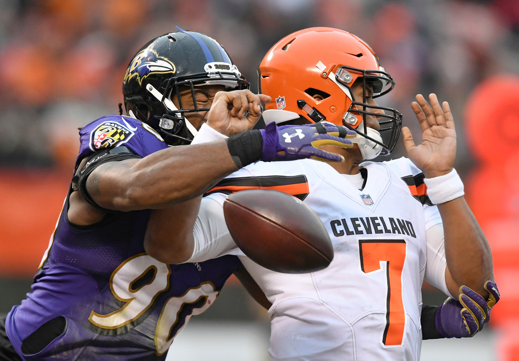 . Baltimore Ravens defensive end Za\'Darius Smith (90) knocks the ball loose from Cleveland Browns quarterback DeShone Kizer (7) during the second half of an NFL football game, Sunday, Dec. 17, 2017, in Cleveland. Ravens nose tackle Brandon Williams scored on a 1-yard fumble recovery. (AP Photo/David Richard)