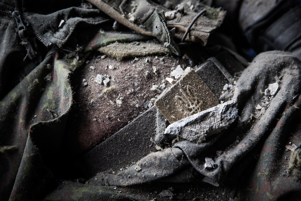 . DONETSK, UKRAINE - FEBRUARY 26:  A dead Ukrainian soldier lies amongst the wreckage of the destroyed Donetsk airport after being recovered by Ukrainian soldier prisoners-of-war who were forced to search through the wreckage by pro-Russian rebels on February 26, 2015 in Donetsk, Ukraine. The Donetsk airport has been one of the most heavily fought over pieces of land between the Ukrainian army and pro-Russian rebels.  (Photo by Andrew Burton/Getty Images)