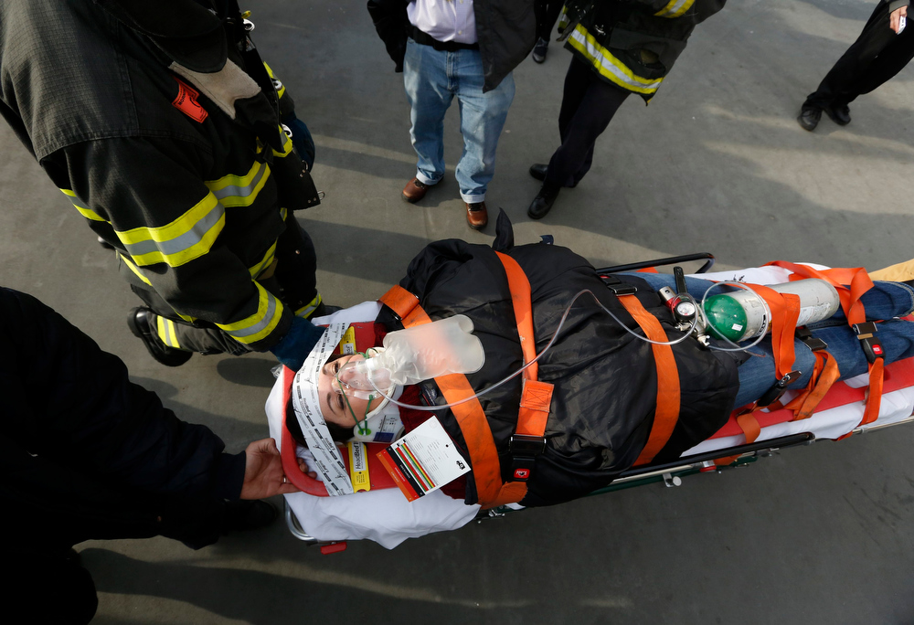 Description of . New York City firemen carry a victim of a commuter ferry crash from the scene in New York, January 9, 2013. A commuter ferry crashed into a pier in lower Manhattan early Wednesday, injuring 57 people, one critically, the New York City Police Department said. Passengers lying on stretchers littered the pier near South Street Seaport, attended to by firefighters and rescue workers who rushed to the scene of the 8:43 a.m. (1343 GMT) hard landing. REUTERS/Brendan McDermid