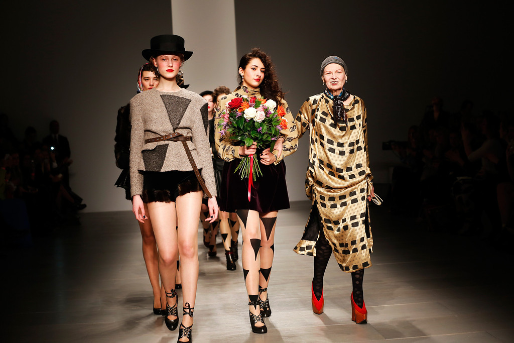. Designer Vivienne Westwood (R) walks with models on the runway after the Vivienne Westwood Red Label show at London Fashion Week AW14 at  on February 16, 2014 in London, England.  (Photo by Tristan Fewings/Getty Images)