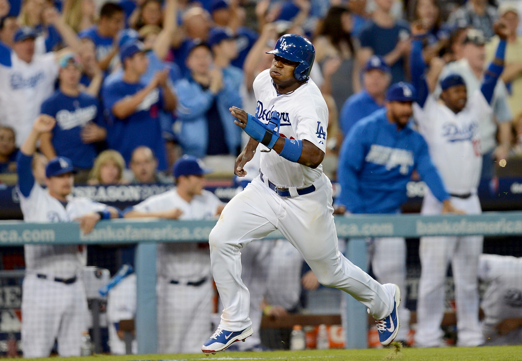 . Los Angeles Dodgers\' Yasiel Puig brings in a run during game 3 of the NLDS at Dodger Stadium Sunday, October 6, 2013. (Photo by Hans Gutknecht/Los Angeles Daily News)