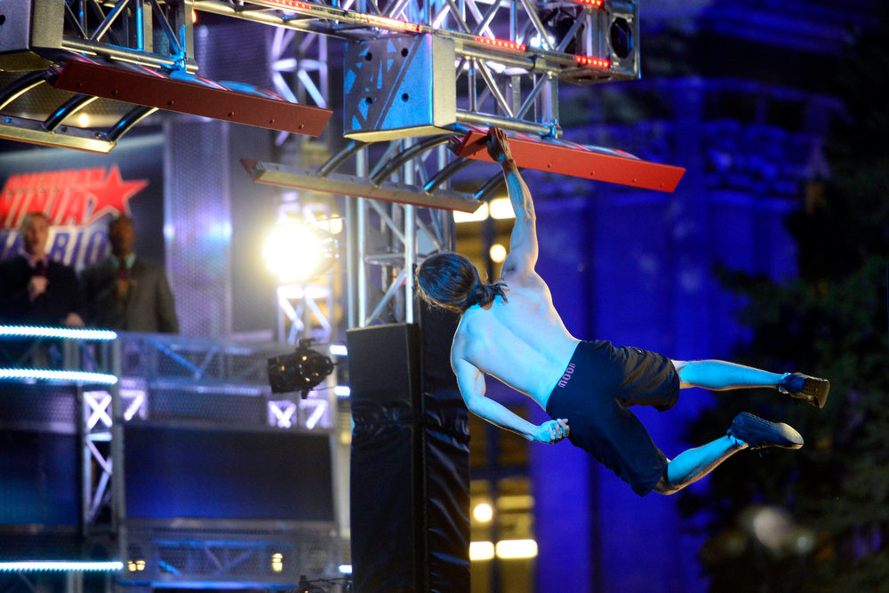 . Isaac Caldiero (dressed as Jesus Christ) showboats for the crowd during his tryout for American Ninja Warrior Denver. Caldiero dominated the course. (Photo by AAron Ontiveroz/The Denver Post)