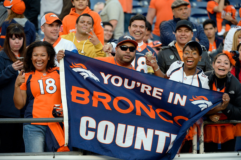 . SAN DIEGO, CA - DECEMBER 14: Denver Broncos fans cheer on as the Denver Broncos defeated the  San Diego Chargers 22-10 December 14, 2014 at Qualcomm Stadium (Photo By John Leyba/The Denver Post)