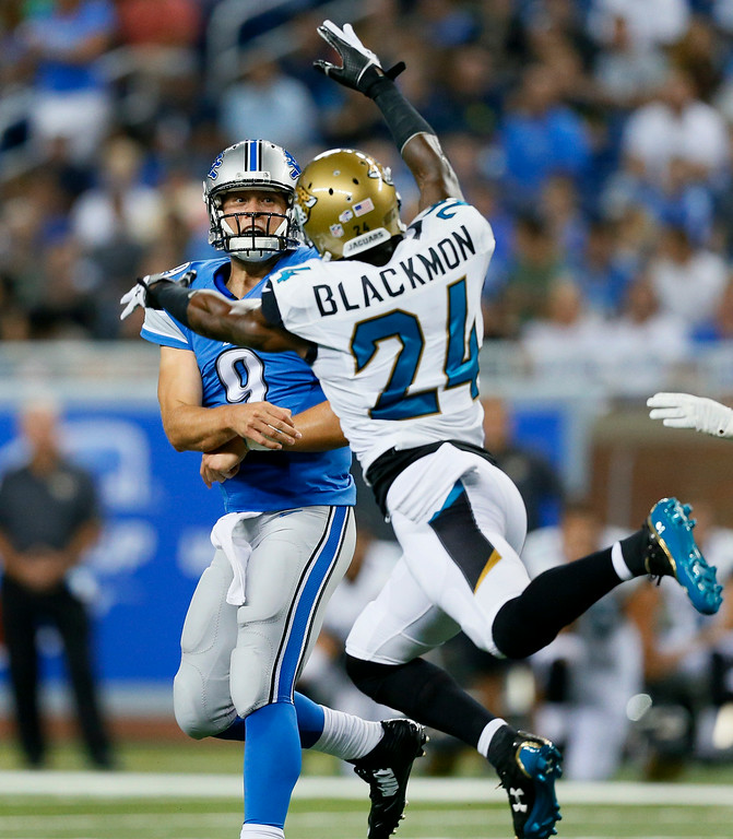 . Jacksonville Jaguars cornerback Will Blackmon (24) pressures Detroit Lions quarterback Matthew Stafford (9) in the first half of a preseason NFL football game at Ford Field in Detroit, Friday, Aug. 22, 2014. (AP Photo/Rick Osentoski)