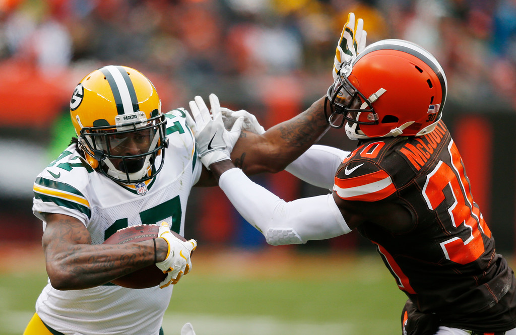 . Green Bay Packers wide receiver Davante Adams (17) holds off Cleveland Browns defensive back Jason McCourty (30) in the second half of an NFL football game, Sunday, Dec. 10, 2017, in Cleveland. (AP Photo/Ron Schwane)