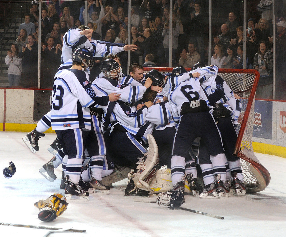 . DENVER, CO. - FEBRUARY 28: Mustangs players surrounded goalie Zach LaRocque who got the win Friday night. Ralston Valley High School beat Monarch 5-1 Friday night, March 1, 2013 to claim the state title at Magness Arena in Denver. (Photo By Karl Gehring/The Denver Post)