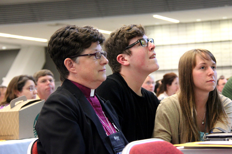 The Rev. Elizabeth A. Eaton, bishop of the Evangelical Lutheran Church in America Northeastern Ohio Synod, awaits news of the election with voting members from her synod.
