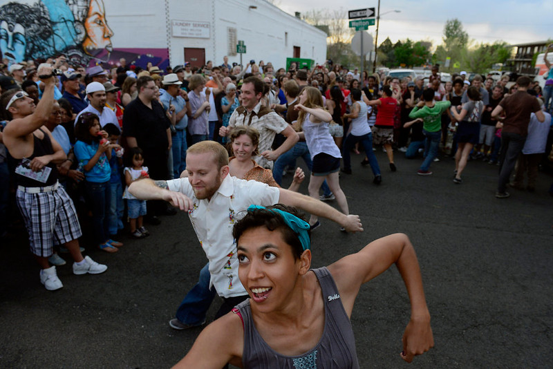 . Sara Deckard, 25, of Denver, dances as part of a swing dance flash mob put on by Community-Minded Dance at the beginning of the first set by the Hazel Miller Band, the headlining band at the Five Points Jazz Festival, May 18, 2013. The festival ran 11am to 8pm on May 18, 2013 and is a free community event highlighting local musicians, art and the historic Denver Five Points neighborhood.  (Photo By Mahala Gaylord/The Denver Post)