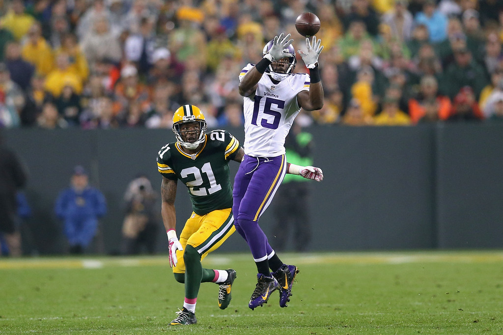 . GREEN BAY, WI - OCTOBER 02:  Greg Jennings #15 of the Minnesota Vikings receives a 17 yard pass against  Ha Ha Clinton-Dix #21 of the Green Bay Packers in the third quarter at Lambeau Field on October 2, 2014 in Green Bay, Wisconsin. (Photo by Jonathan Daniel/Getty Images)