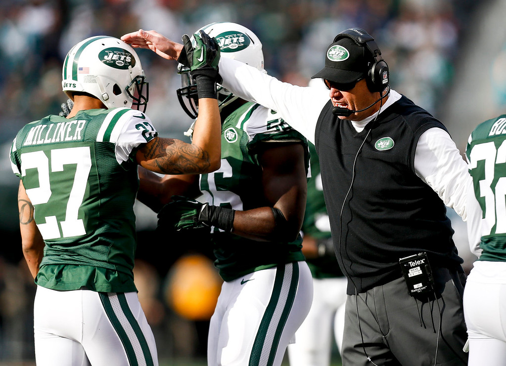 . Head coach Rex Ryan of the New York Jets  greets Dee Milliner #27 of the New York Jets during their game against the Miami Dolphins at MetLife Stadium on December 1, 2013 in East Rutherford, New Jersey.  (Photo by Jeff Zelevansky/Getty Images)