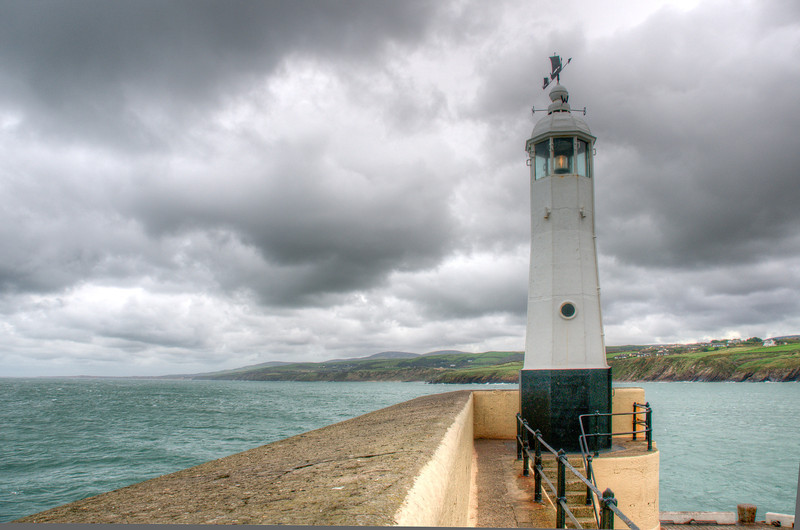 Close-up shot of white lighthouse on cliff at Isle of Man