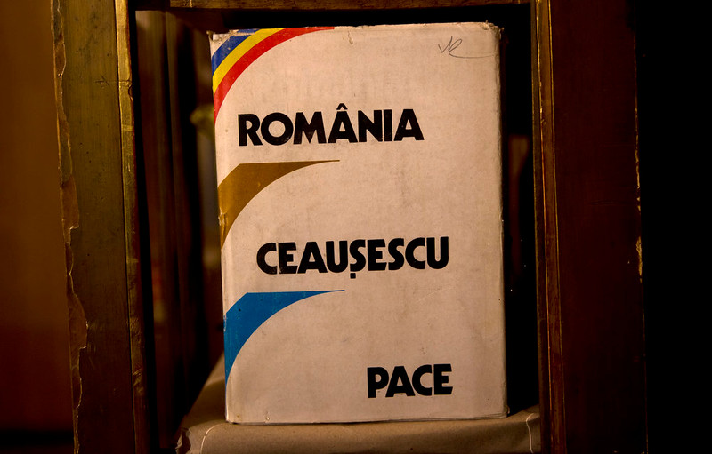 ". A picture taken on Dec. 15, 2014 shows books and magazines, either about or allegedly authored by communist dictator Nicolae Ceausescu, at the military garrison, turned museum, in Targoviste, Romania, where he and his wife Elena spent their final days before being executed on Dec. 25, 1989. Title reads ""Romania-Ceausescu-Peace\"".  (AP Photo/Vadim Ghirda)"