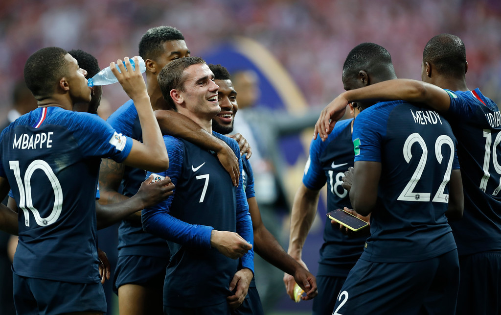 . France\'s Antoine Griezmann, centre, celebrates with teammates after France defeated Croatia in the final match between France and Croatia at the 2018 soccer World Cup in the Luzhniki Stadium in Moscow, Russia, Sunday, July 15, 2018. France won the game 4-2. (AP Photo/Francisco Seco)