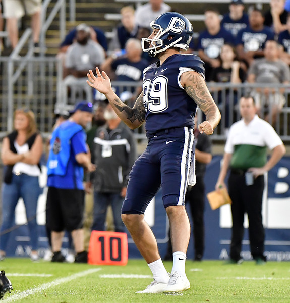 8/29/2019 Mike Orazzi   Staff UConn football punter Luke Magliozzi (99)during the season opening game with Wagner College on Thursday night.