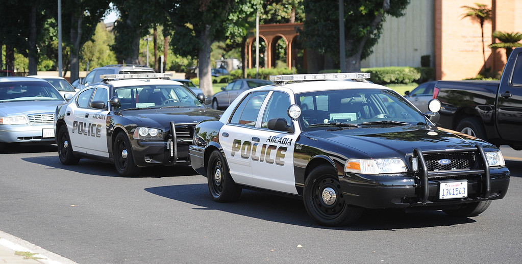 . Arcadia Police units sits in front after a lockdown at Arcadia High School in Arcadia, Calif. on Thursday, Sept. 12, 2013.   (Photo by Keith Birmingham/Pasadena Star-News)