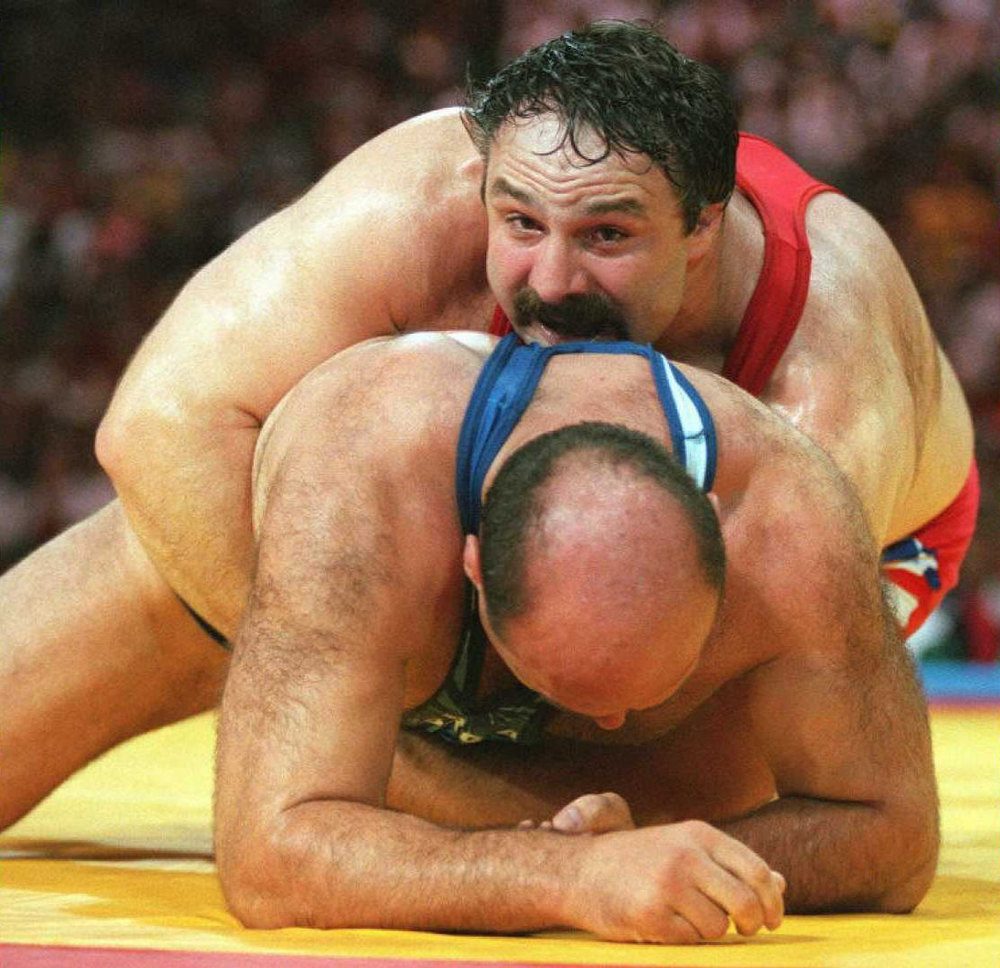 Description of . Bruce Baumgartner of the US (top) holds Zaza Turmanidze of Georgia down in their 130kg Olympic freestyle wrestling match at the Georgia World Congress Center in Atlanta, Georgia, 01 Aug. Baumgartner won 14-2. GEORGES GOBET/AFP/Getty Images