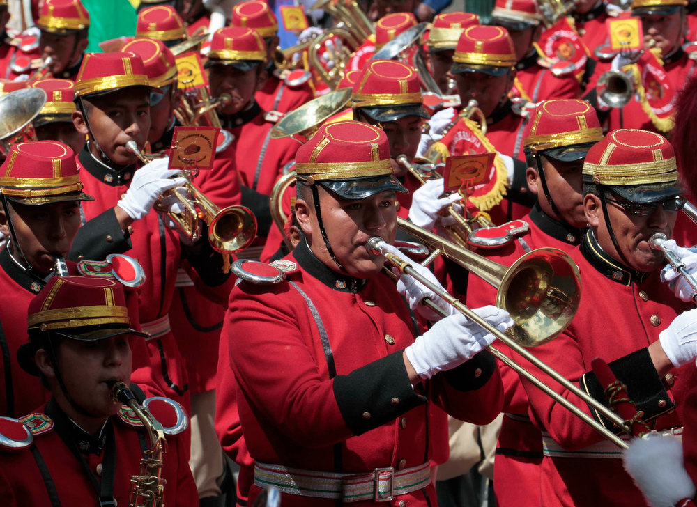 Description of . Bolivia's presidential band perform during celebrations of third year of the new Pluri-national state of Bolivia and President Evo Morales' eighth continuous year of government, the second longest government in the history of Bolivia, in La Paz January 22, 2013. Morales, first indigenous president in the country's history, will celebrate on Tuesday, 2558 days in the Bolivian Presidency. Morales took office on January 22, 2006, after winning the presidential election with 53.7% and he was re-elected for a second term on 2010-2015 with 64% of the votes according local media. REUTERS/David Mercado