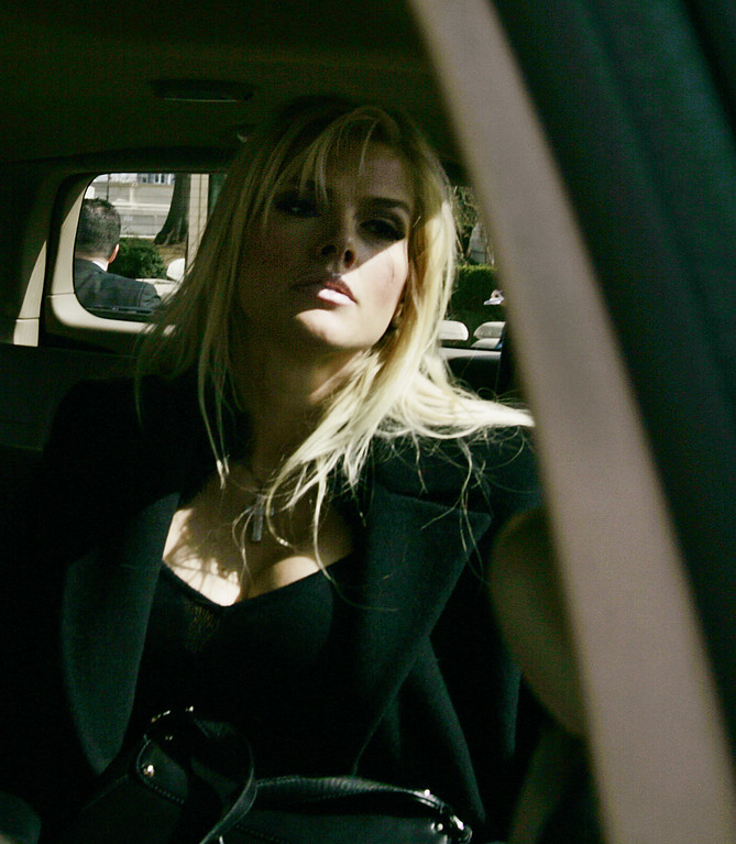 . Anna Nicole Smith, sits inside her vehicle, as she leaves after a hearing at the U.S. Supreme Court, Tuesday, Feb. 28, 2006, in Washington. With an oil fortune on the line, the former stripper  encountered a sympathetic audience at the Supreme Court on Tuesday. (AP Photo/Manuel Balce Ceneta)