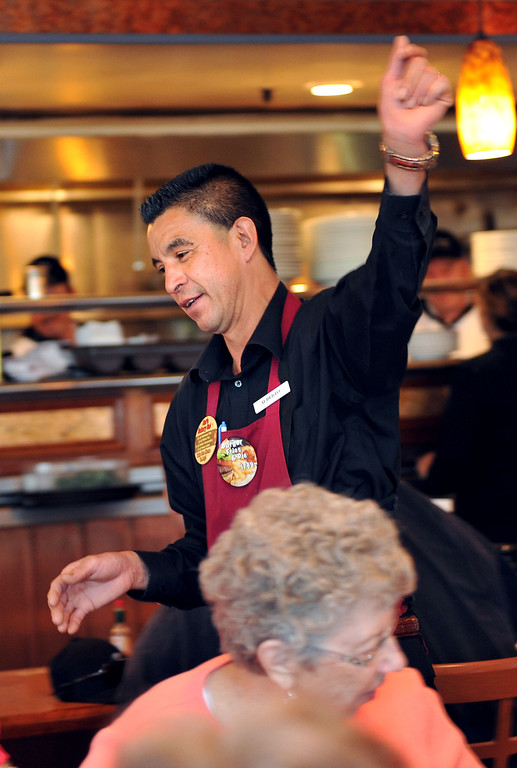 . 2/28/13 - Alberto Torres, an employee of 33 years waves farewell at Hof\'s Hut, 6257 East 2nd Street in Long Beach which was packed with customers on its\' final day of service Thursday. Hugs and farewells filled the booths as regulars came in for their last meal at the eatery. Some employees will transfer to other restaurants and they\'re hopeful their regulars will follow. Photo by Brittany Murray / Staff photographer