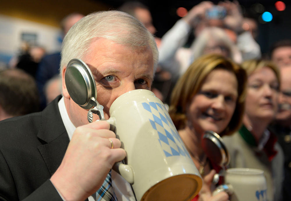 Description of . Horst Seehofer, State Premier of Bavaria and leader of the Christian Social Union drinks beer during the CSU Ash Wednesday event in Passau, southern Germany, on March 5, 2014. Party sympathizer of the Bavarian Christian Social Union party (CSU) took part at the traditional political event. (CHRISTOF STACHE/AFP/Getty Images)