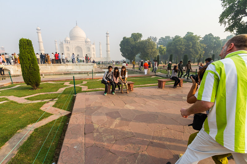 Tourists take photos of themselves in front of the Taj Mahal, Agra, India