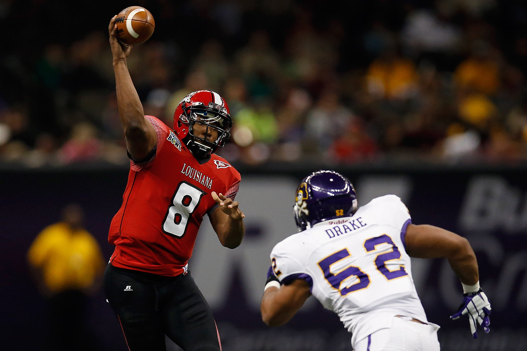 . Terrance Broadway #8 of the Louisiana-Lafayette Ragin Cajuns throws a pass against the East Carolina Pirates during the R+L Carriers New Orleans Bowl at Mercedes-Benz Superdome on December 22, 2012 in New Orleans, Louisiana.  (Photo by Chris Graythen/Getty Images)