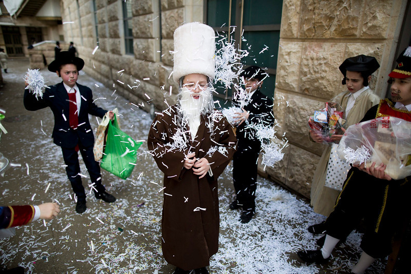 . Ultra Orthodox Jewish boys dressed in traditional Purim costumes play in the Mea Shaarim neighborhood in Jerusalem, Israel, 16 March 2014. The holiday of Purim celebrates the Jews\' salvation from genocide in ancient Persia, as recounted in the Scroll of Esther.  (EPA/ABIR SULTAN)