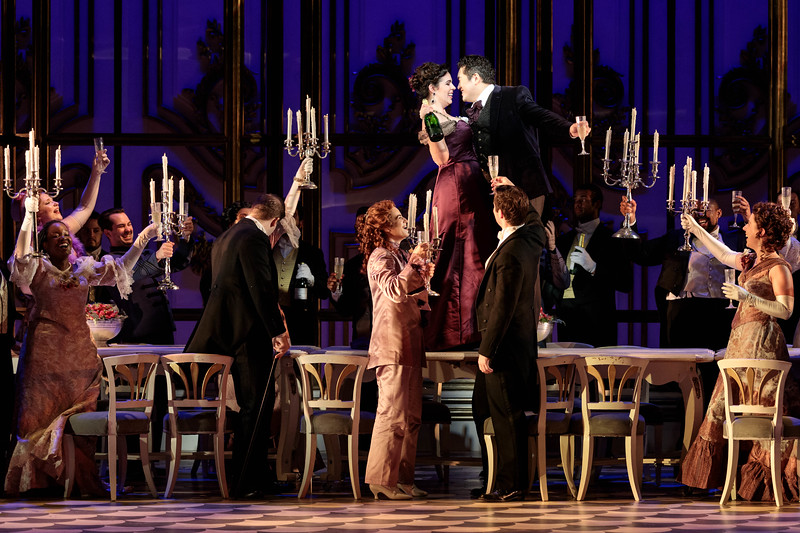 """(Center) Amanda Woodbury as Violetta, Kang Wang as Alfredo and members of the ensemble in The Glimmerglass Festival's 2019 production of """"La traviata."""" Photo: Karli Cadel/The Glimmerglass Festival"""
