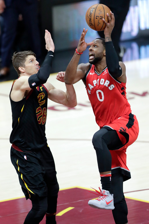. Toronto Raptors\' CJ Miles (0) shoots over Cleveland Cavaliers\' Kyle Korver in the second half of Game 4 of an NBA basketball second-round playoff series, Monday, May 7, 2018, in Cleveland. (AP Photo/Tony Dejak)