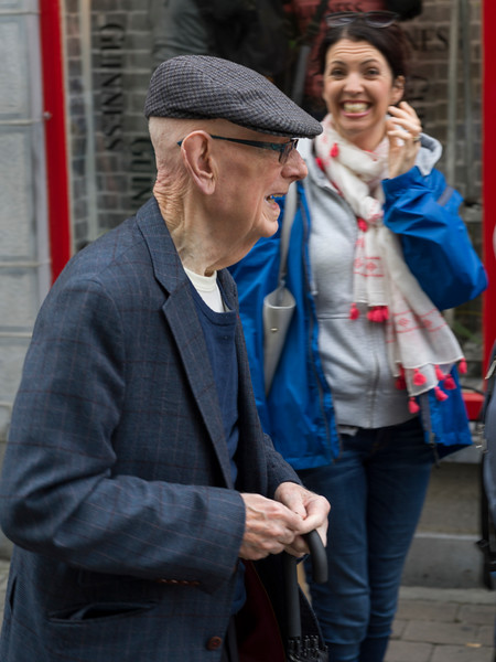 Senior man and a woman laughing along the street, Galway City, County Galway, Ireland