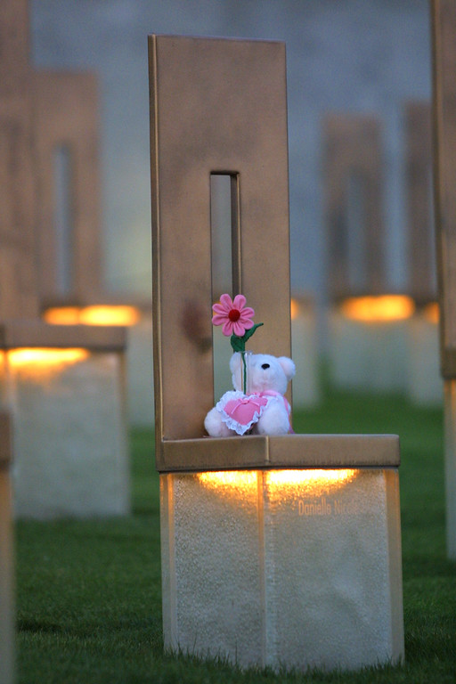 . A stuffed bear sits on a chair that represents a person who was killed in the 1995 Oklahoma bombing, June 11, 2001 at the Oklahoma National Memorial in Oklahoma City, Oklahoma on the day of Timothy McVeigh\'\'s execution. (Photo by Joe Raedle/Getty Images)