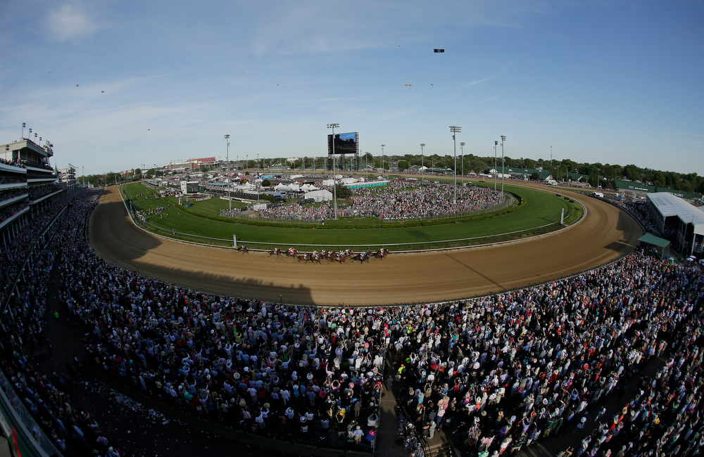 Description of . Horses run during the 140th running of the Kentucky Derby horse race at Churchill Downs Saturday, May 3, 2014, in Louisville, Ky. (AP Photo/Charlie Riedel)