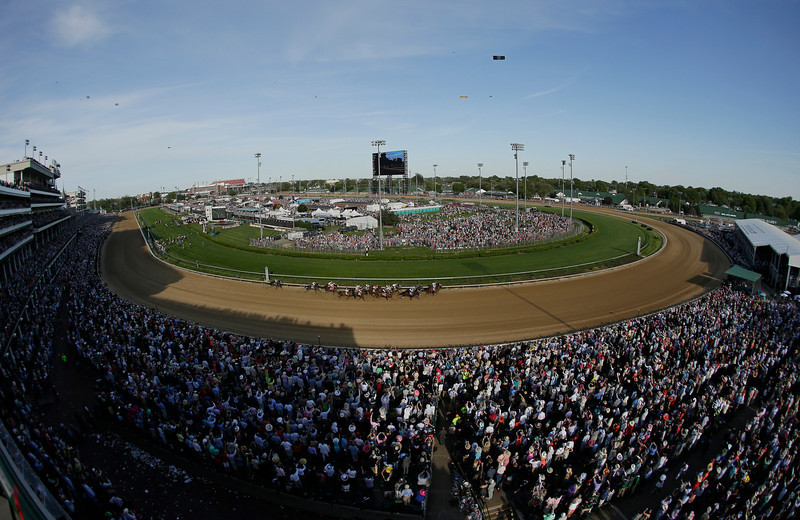 . Horses run during the 140th running of the Kentucky Derby horse race at Churchill Downs Saturday, May 3, 2014, in Louisville, Ky. (AP Photo/Charlie Riedel)
