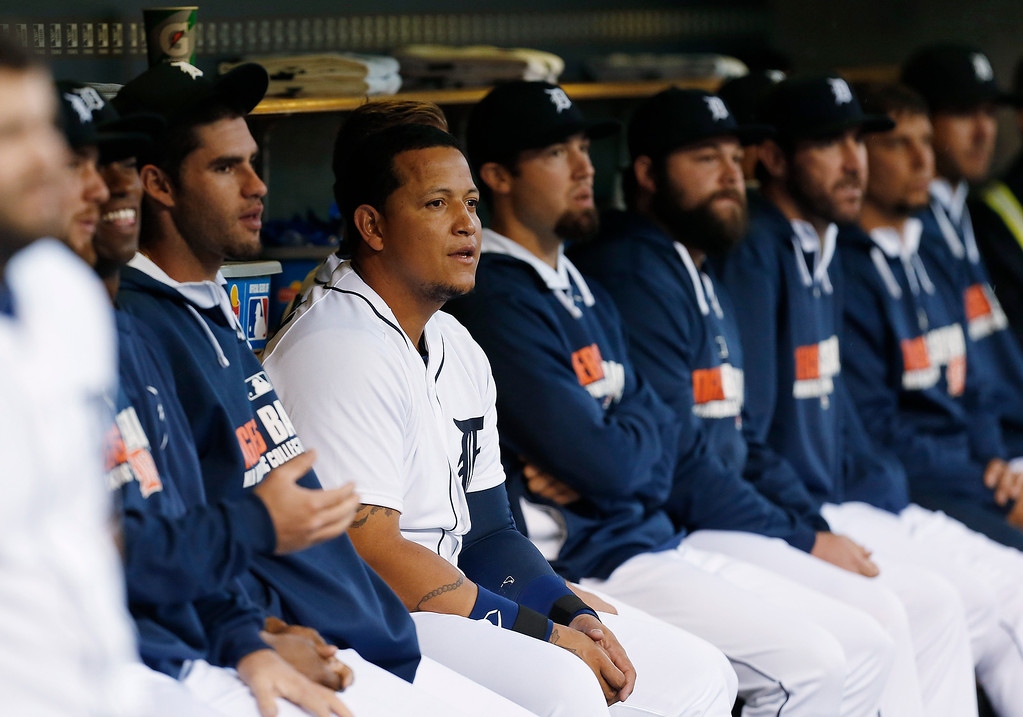 . Detroit Tigers first baseman Miguel Cabrera watches from the bench after hitting a two-run home run against the Houston Astros in the first inning of a baseball game in Detroit Wednesday, May 7, 2014. (AP Photo/Paul Sancya)