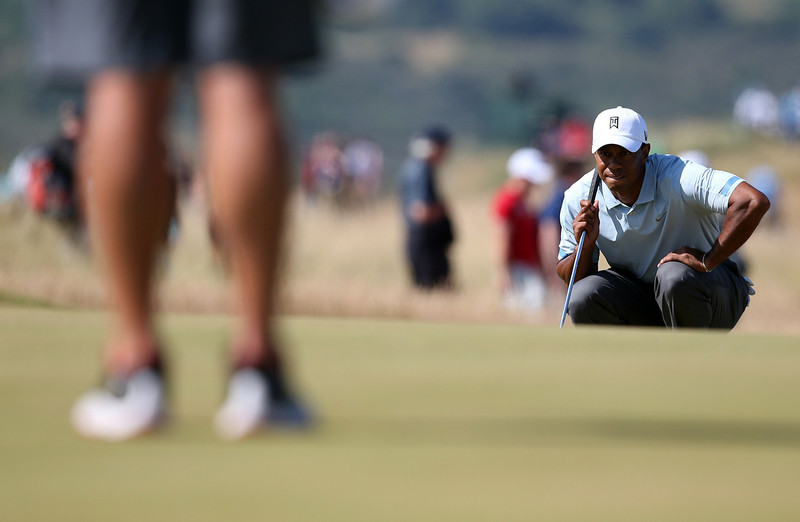 . US golfer Tiger Woods lines up his putt on the fifth green during the second round of the 2013 British Open Golf Championship at Muirfield golf course at Gullane in Scotland on July 19, 2013 . ADRIAN DENNIS/AFP/Getty Images