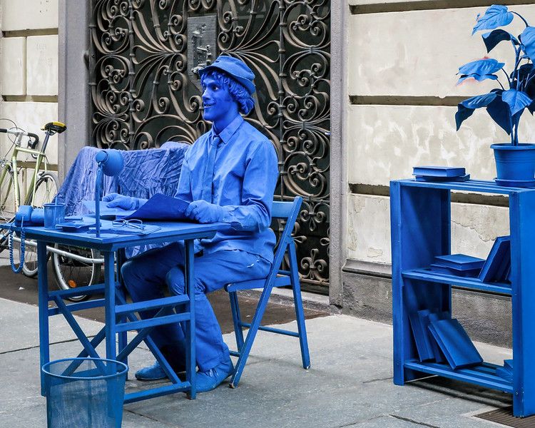 blue human manequin on the street