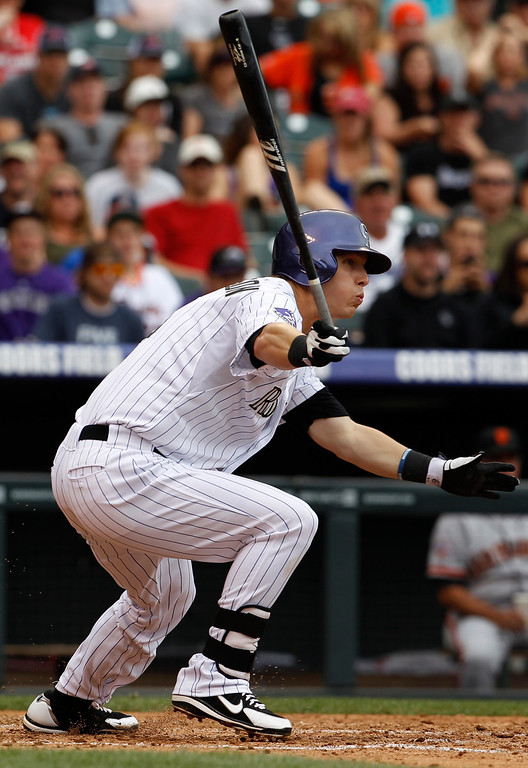 . Colorado Rockies\' Corey Dickerson grounds out against the San Francisco Giants in the fifth inning of a baseball game in Denver on Saturday, June 29, 2013. (AP Photo/David Zalubowski)