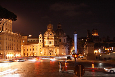 Trajan's Column (right center) and busy streets at night