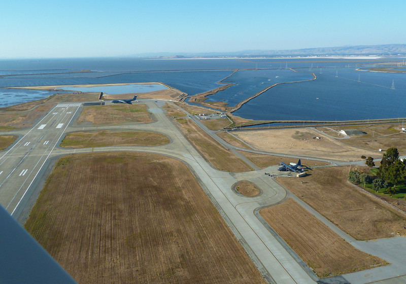 Lifting off vertically above the Moffett Field runway.