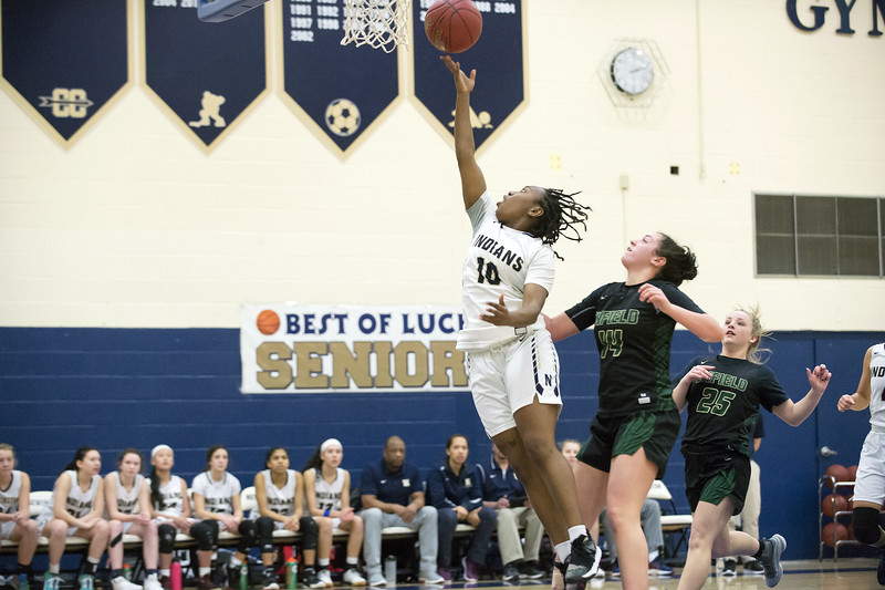 02/20/20   Wesley Bunnell   Staff  Newington girls basketball defeated Enfield on thursday night at home in the first round of the conference tournament.  Ashanti Frazier (10).