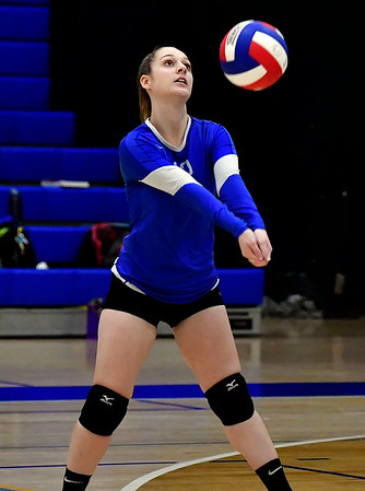 10/25/2018 Mike Orazzi | Staff Plainville's Margaret Cronkhite (12) during a loss to Kennedy during girls volleyball in Plainville Thursday night.